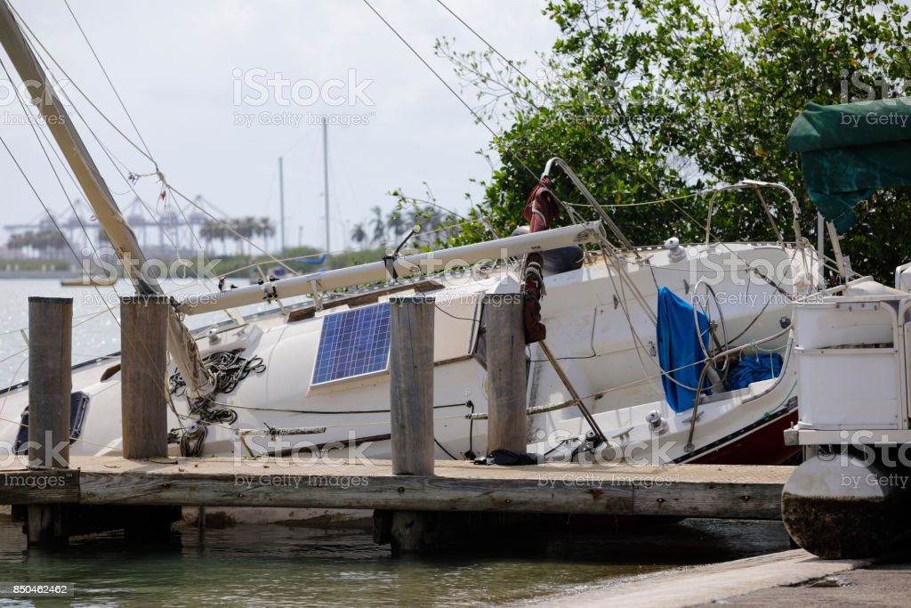 Sail boat washed ashore from Hurricane Irma Miami stock photo