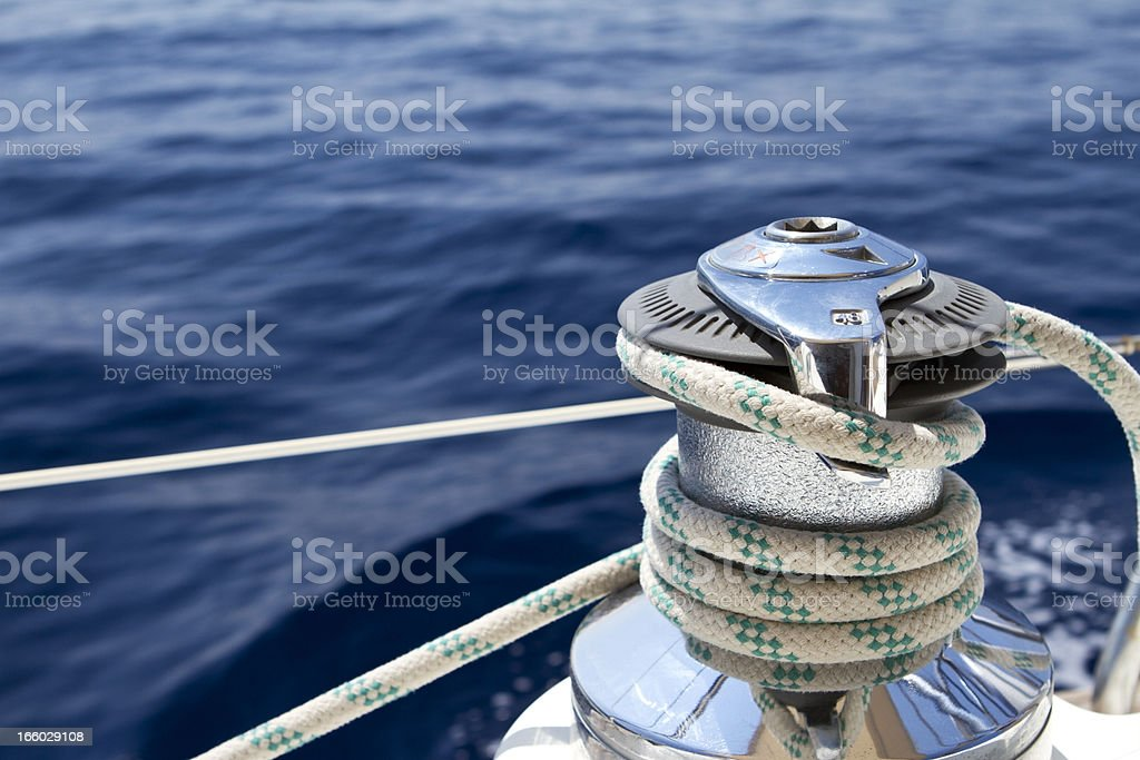 Sail boat winch with tight rope stock photo