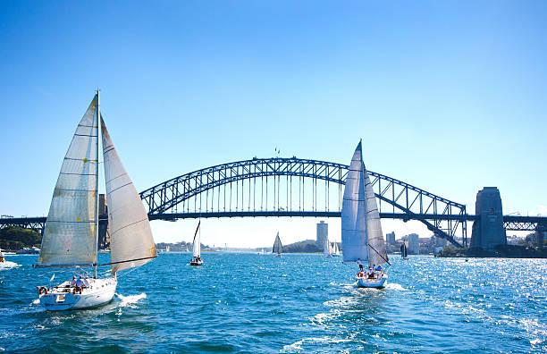 Sail Boating at Sydney Harbor Bridge, Australia stock photo