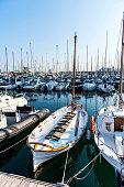 Sail boats in Port Vell marina, Barcelona, Spain.
