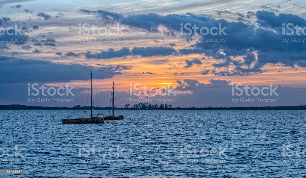 Sail Boats on lake at Dusk stock photo