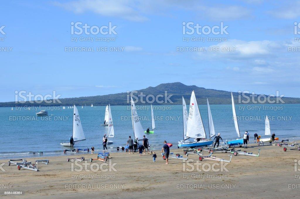 Sail boats on Narrow Neck Beach against Rangitoto island Auckland stock photo