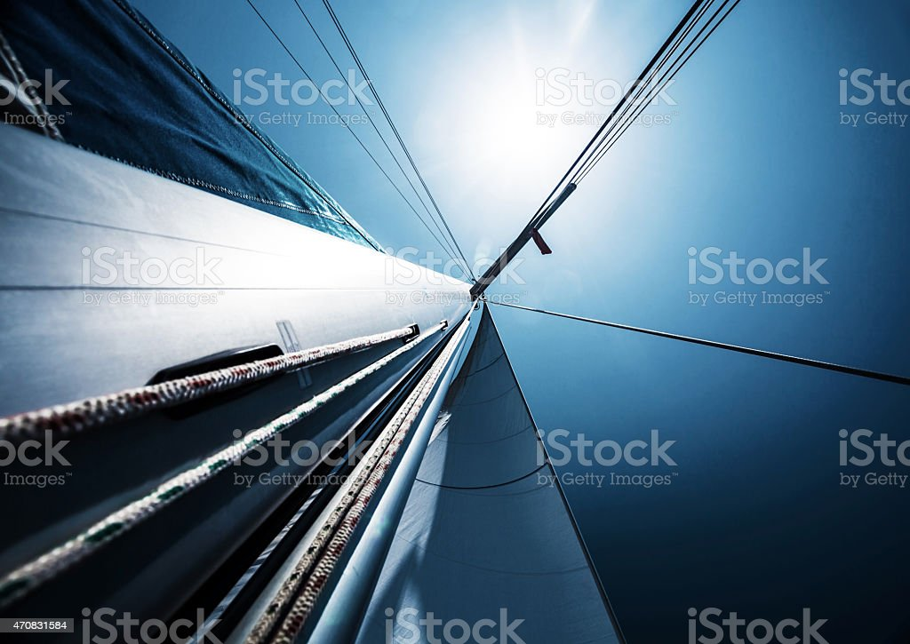 Sail over blue clear sky stock photo