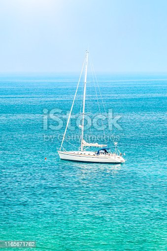 Sailboat among beautiful blue sea in sunny day, summer traveling on the water transport, luxury summertime vacation