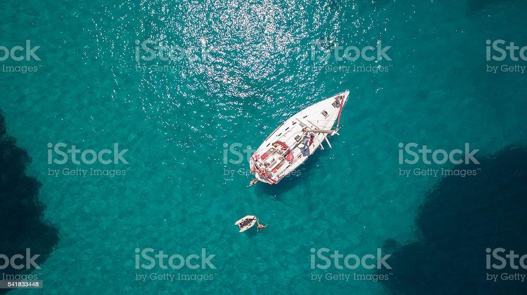 Sailboat anchored on Alyki bay on Thassos island, Greece стоковое фото