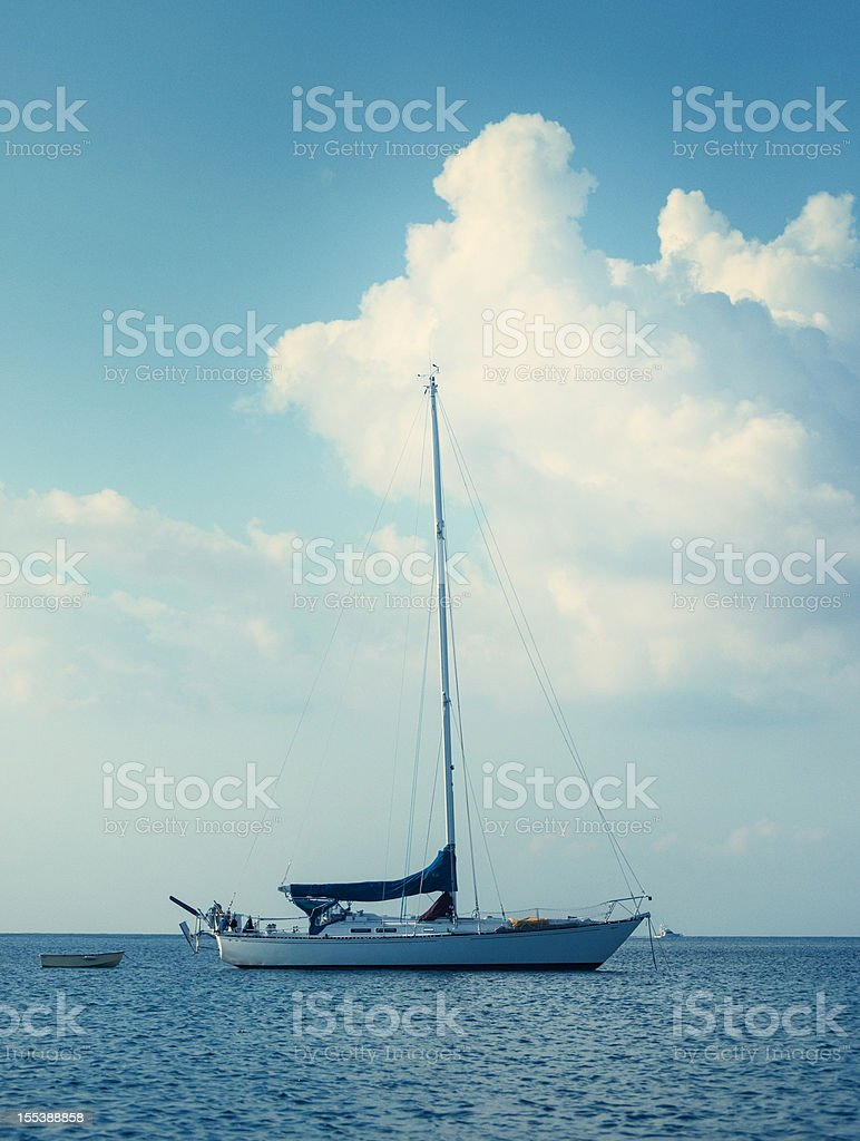 sailboat anchored stock photo
