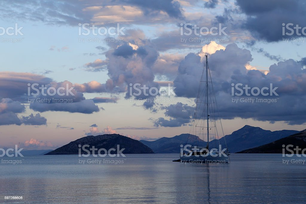 Sailboat and cloudy sky, Leros Island. royalty-free stock photo