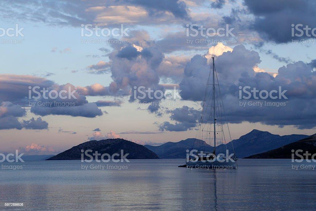 Sailboat and cloudy sky, Leros Island. Lizenzfreies stock-foto