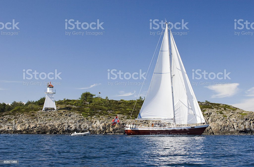 Sailboat and lighthouse stock photo
