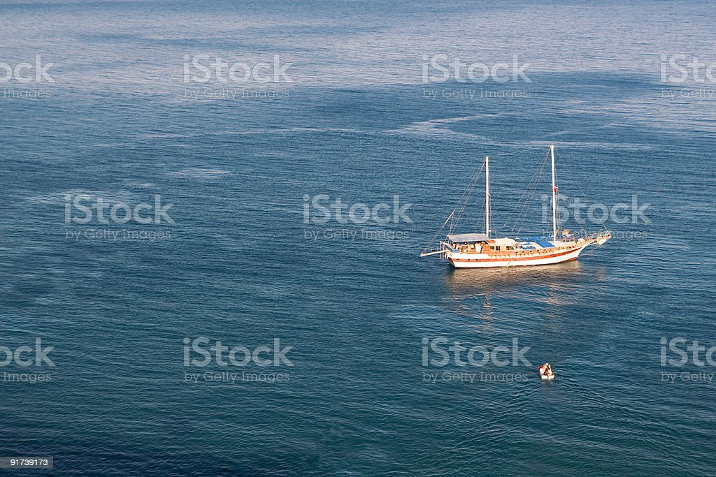 Sailboat and motorboat in sea royalty-free stock photo