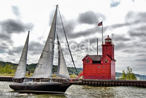 istock sailboat and red lighthouse 176534741