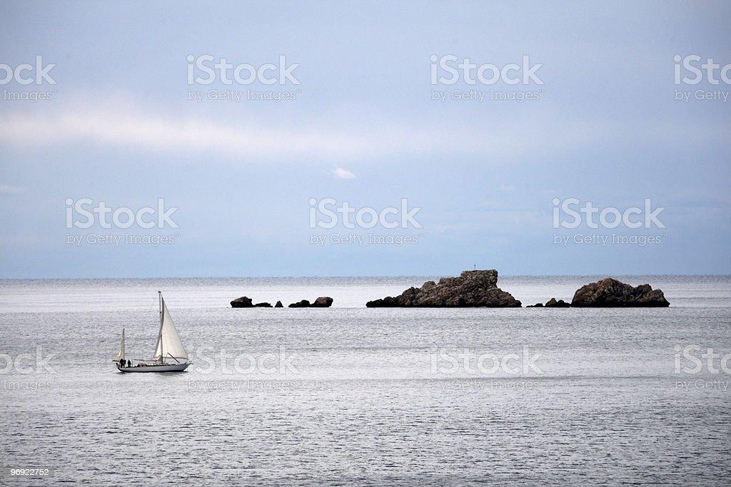 Sailboat and rocks in Croatia royalty-free stock photo