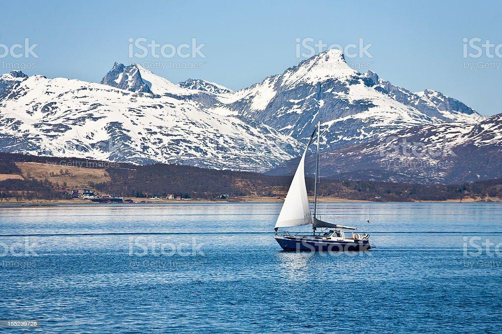 Sailboat and rocky coast royalty-free stock photo