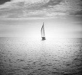 Sailboat cruising on sea, Toronto, Canada
