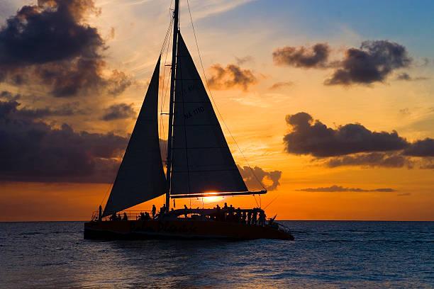 sailboat and sunset - katamaran bildbanksfoton och bilder