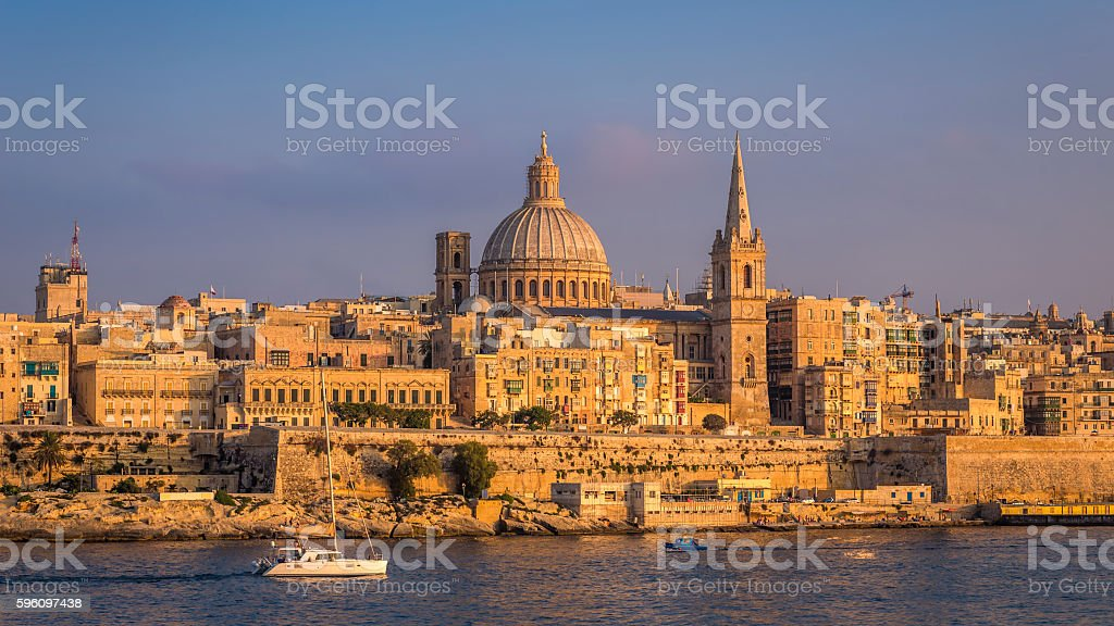 Sailboat and the famous St.Paul's Cathedral with Valletta at sunset royalty-free stock photo