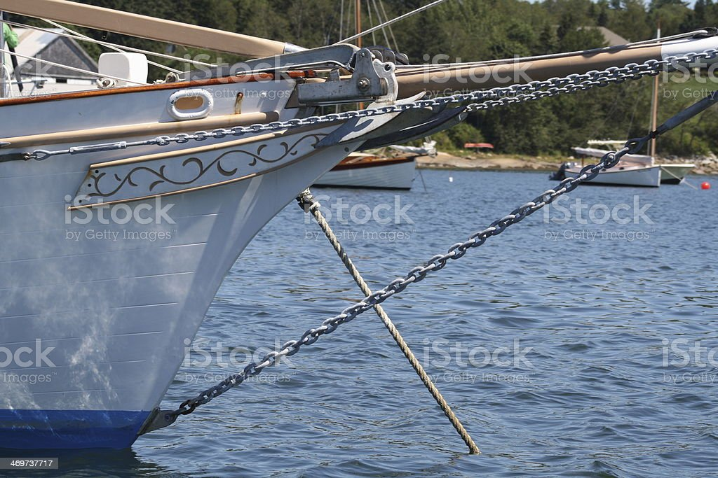 Sailboat at Anchor in a Maine Harbor royalty-free stock photo