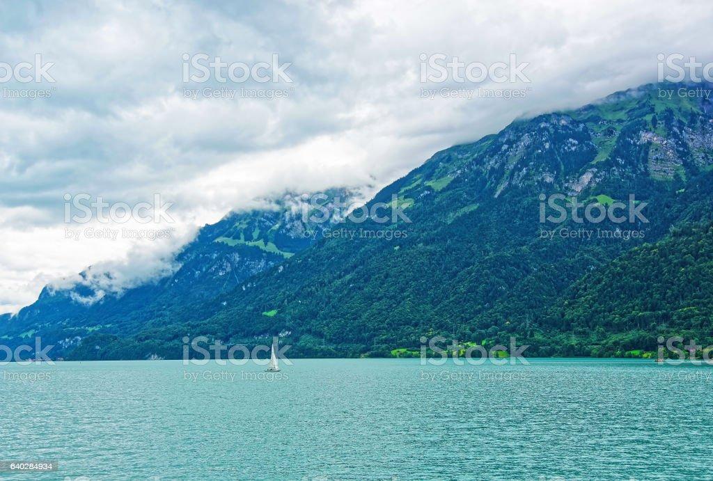 Sailboat at Lake Brienz and Brienzer Rothorn mountain Bern Switzerland stock photo