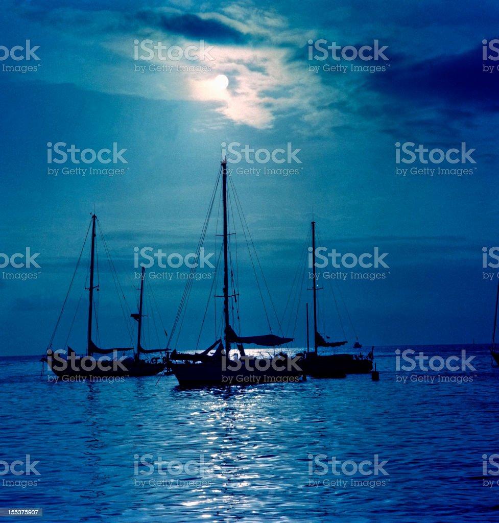Sailboat at night with full moon. royalty-free stock photo
