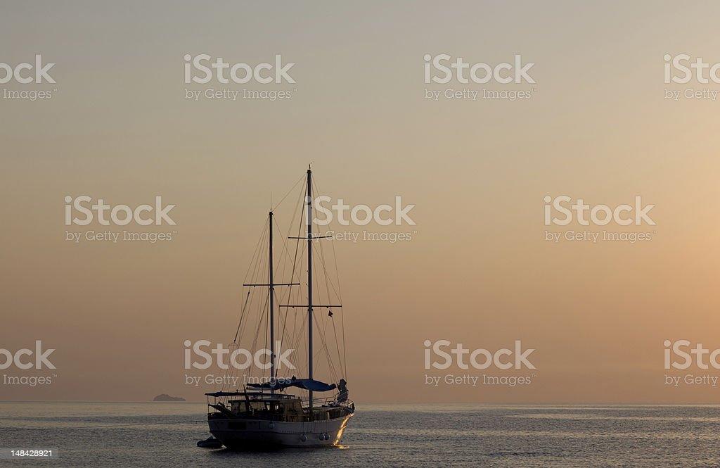 Sailboat at Sunset in mediterranean sea royalty-free stock photo