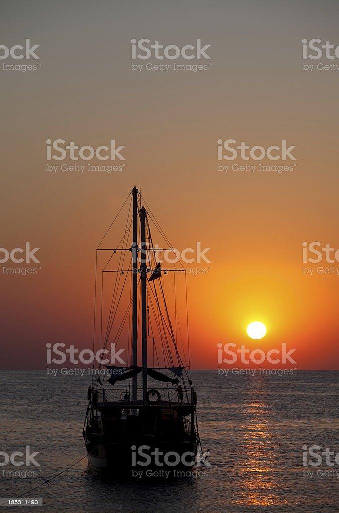 Sailboat at Sunset in mediterranean sea stock photo