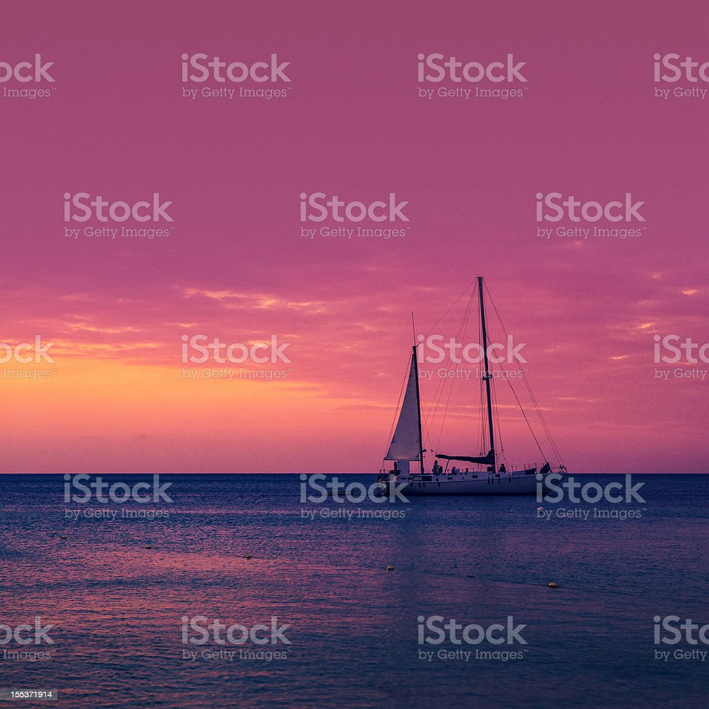 sailboat at sunset stock photo