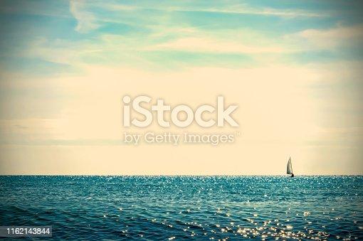 sailboat at the horizon retro background