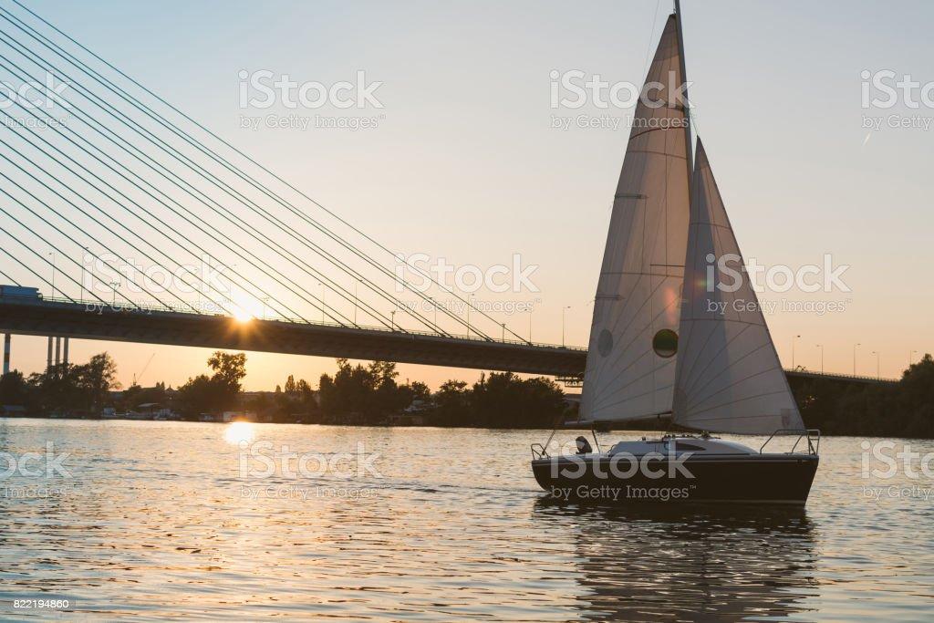 Sailboat at the sunset stock photo