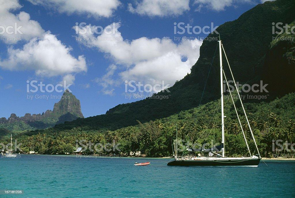 Sailboat, bay and tropical mountain peak royalty-free stock photo