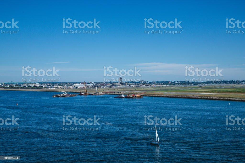 Sailboat by Logan Airport stock photo