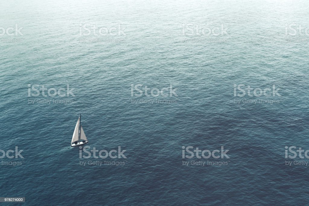 sailboat challenge the sea, aerial view royalty-free stock photo