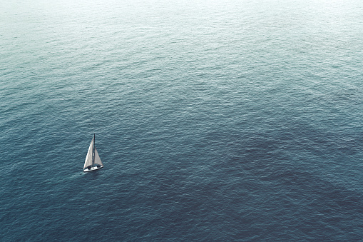 istock sailboat challenge the sea, aerial view 978274000