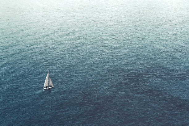 sailboat challenge the sea, aerial view stock photo