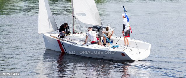 1011210354istockphoto Sailboat Crew in Teamwork 537506406