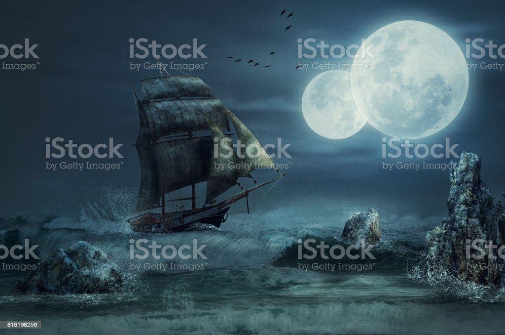 Sailboat goes onto a rocks stock photo