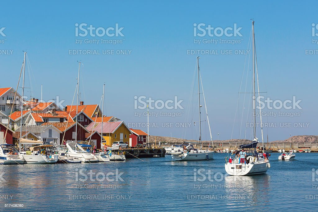 Sailboat heading out to sea from the marina in Grundsund stock photo