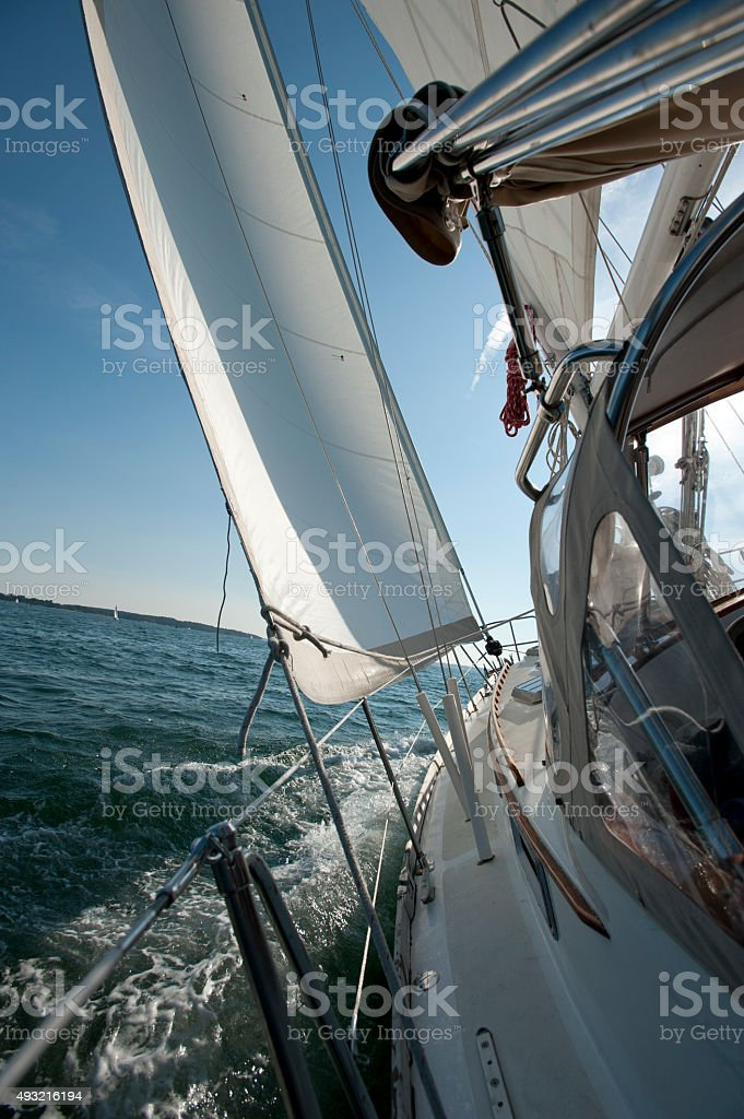 Sailboat heeling on a sunny day stock photo