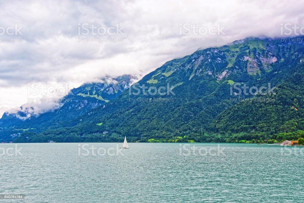 Sailboat in Lake Brienz and Brienzer Rothorn mountain Bern Switzerland stock photo