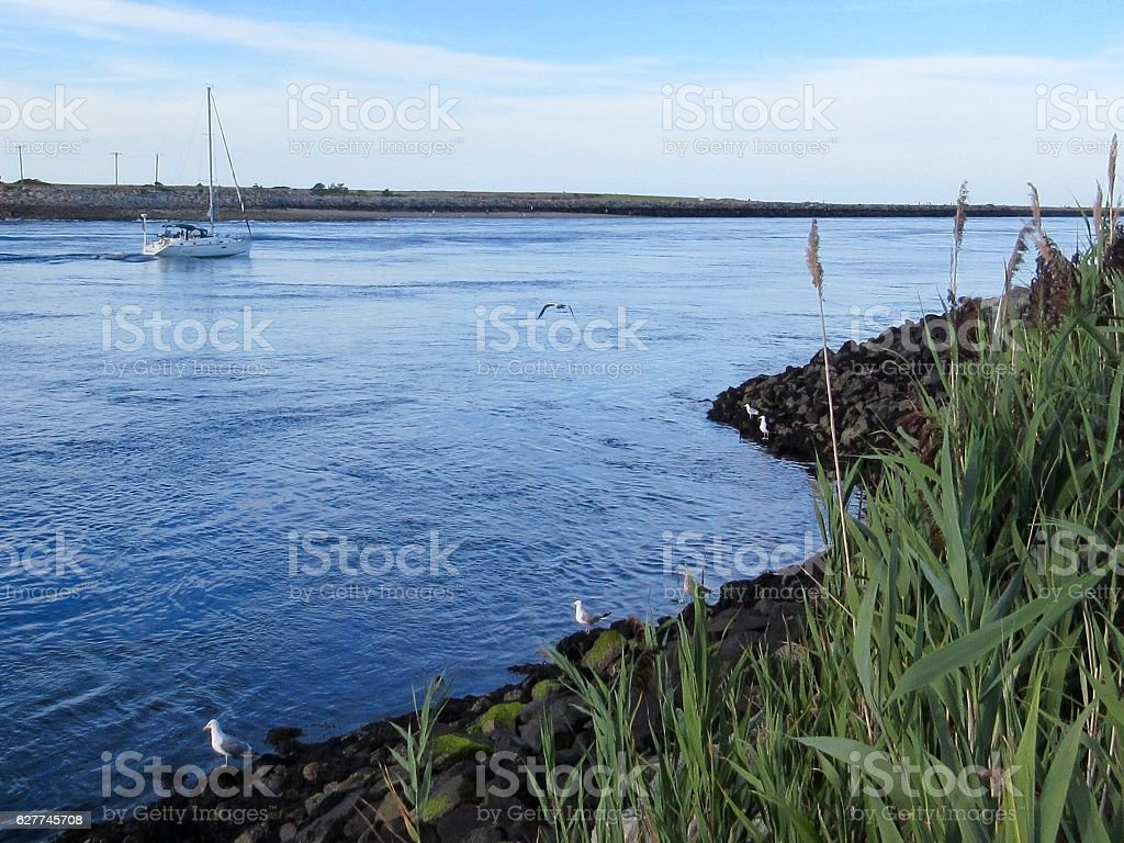 Sailboat in the Cape Cod Canal stock photo