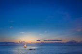 Small sailboat on a calm sea in Penzance, Cornwall, England, UK