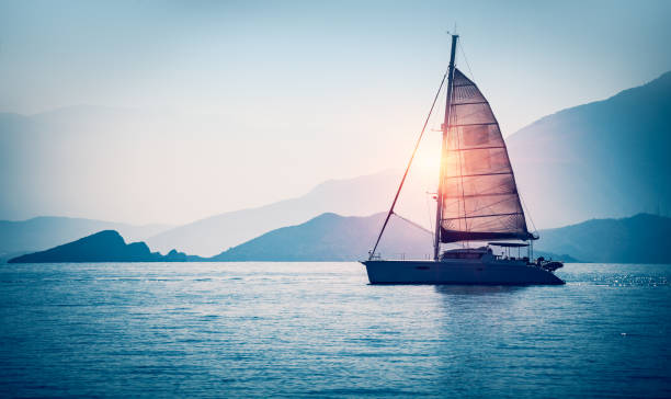 sailboat in the sea - sail stock pictures, royalty-free photos & images