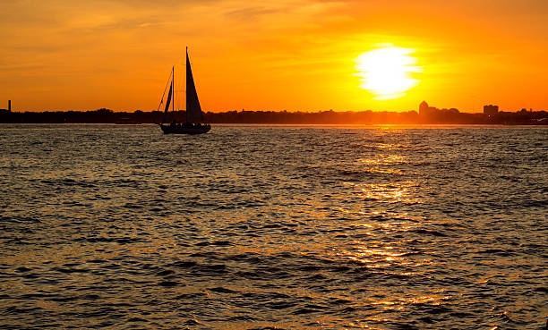 Sailboat in the sunset stock photo