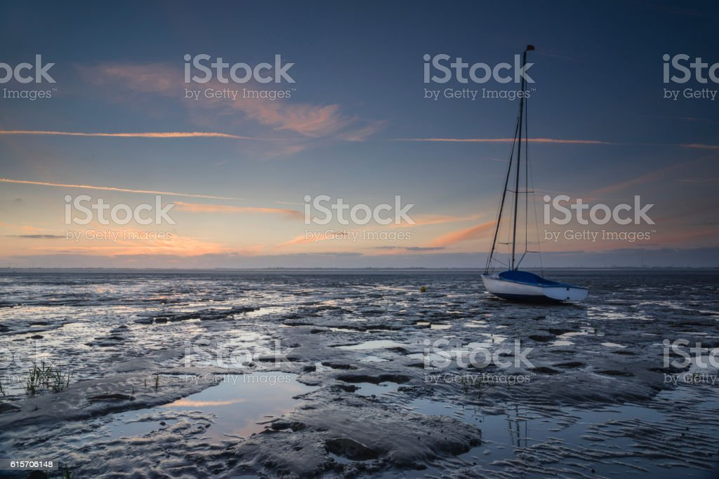 Sailboat in the wadden sea at dusk stock photo
