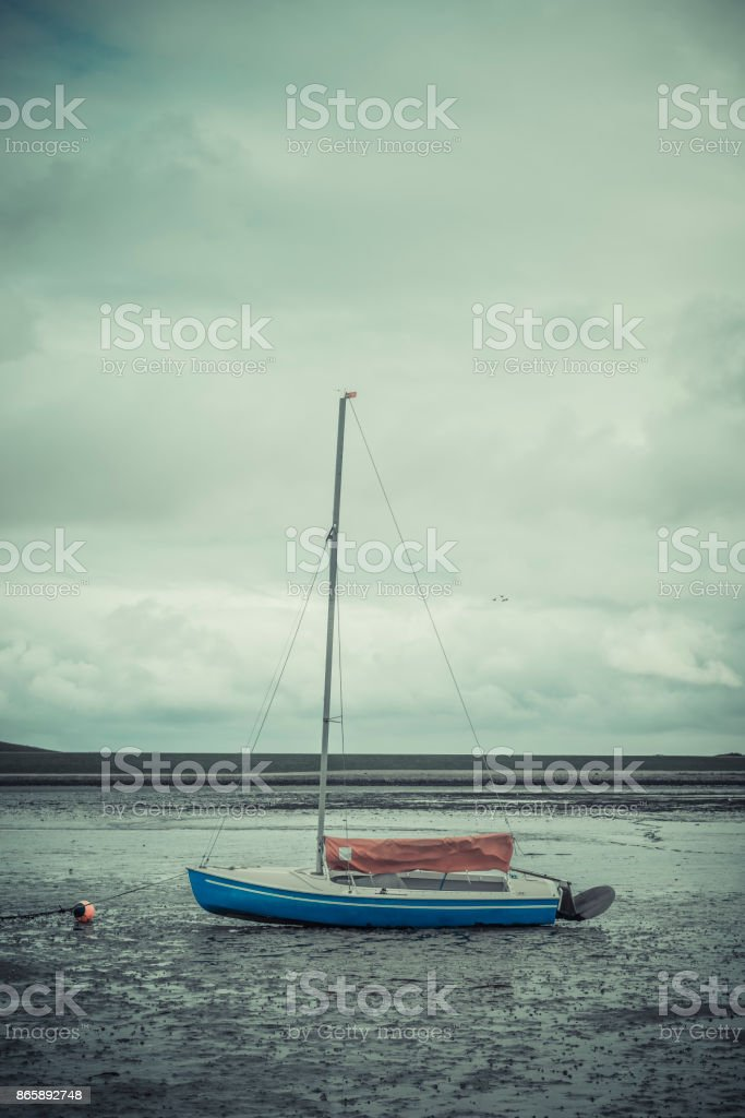 Sailboat in the wadden sea stock photo