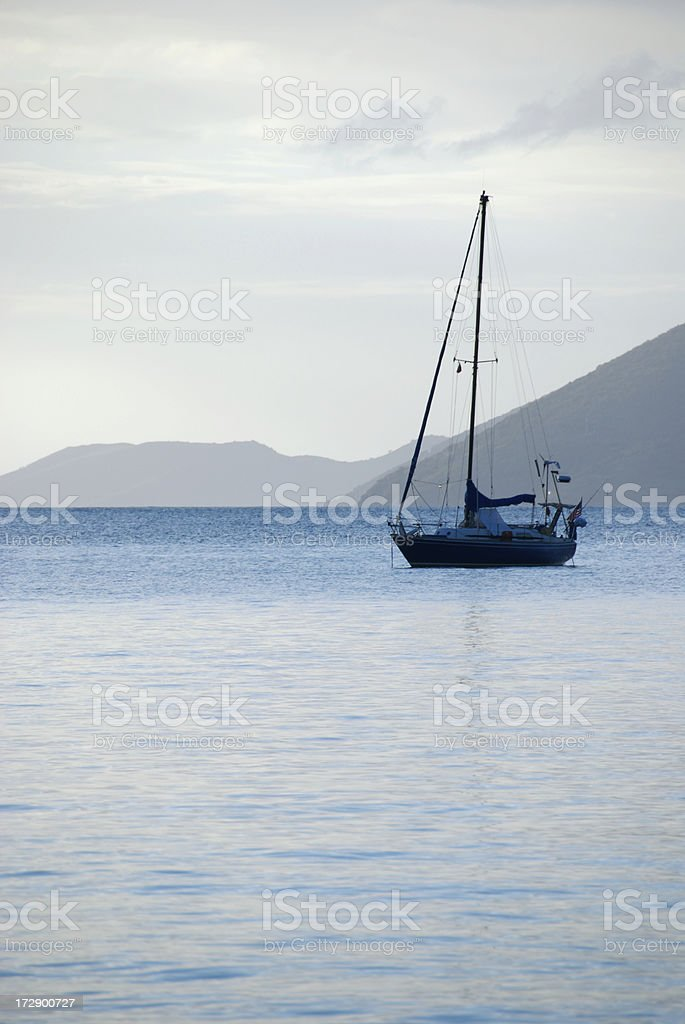 Sailboat Moored in Tranquil Bay royalty-free stock photo