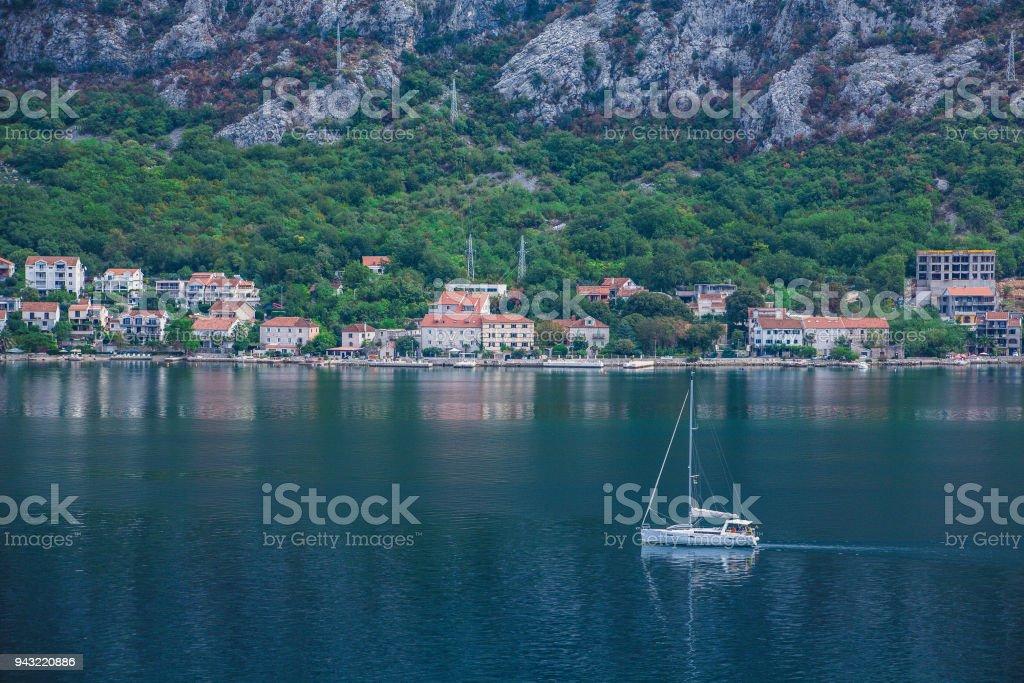 Sailboat Motoring Beyond Montenegro Village stock photo