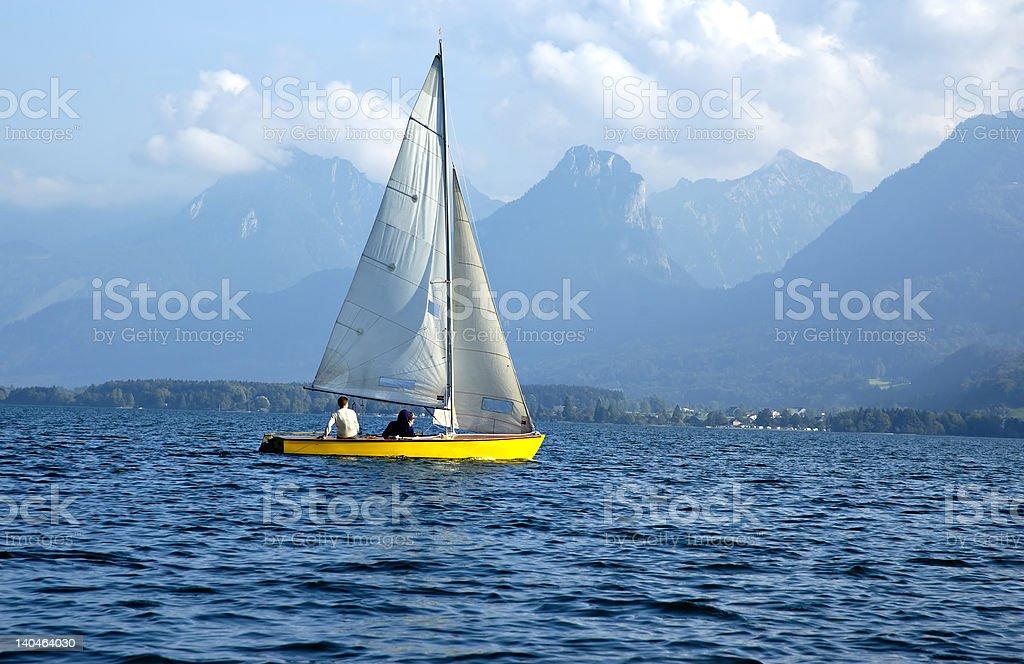 Sailboat on a lake royalty-free stock photo