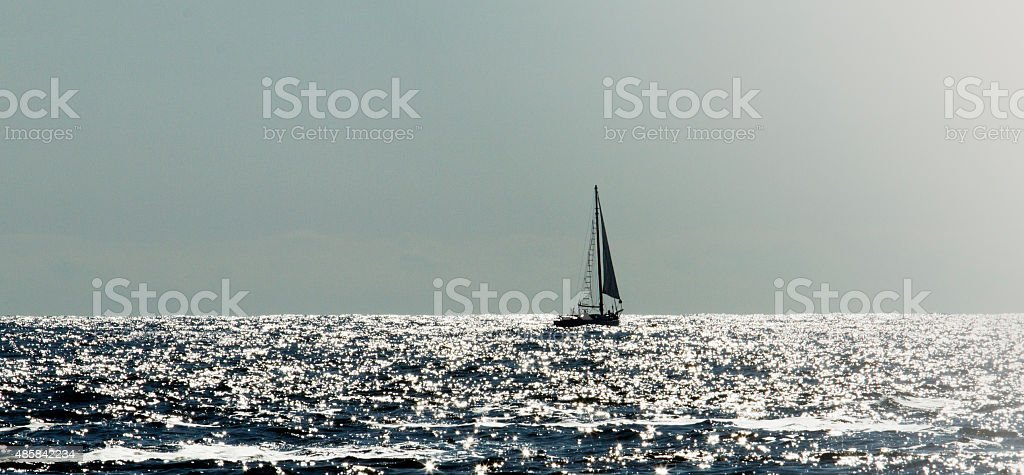 Sailboat on a sparkling sea stock photo
