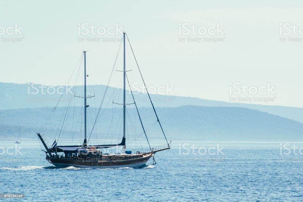 Sailboat on blue sea background stock photo
