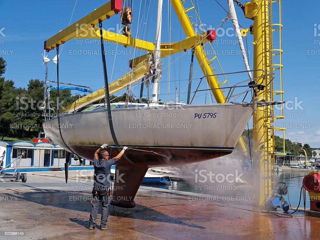 Sailboat on crane stock photo